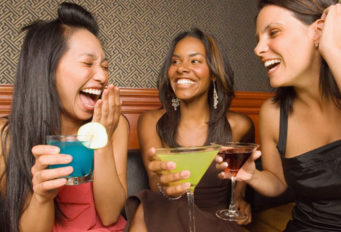 getty_rf_photo_of_women_laughing_in_bar